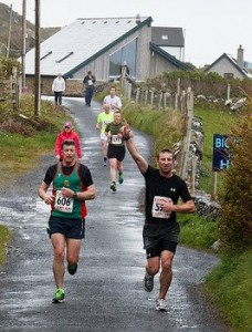 Michael McNeela (left) sets out on the road to win his second Croi Inishbofin Half (photo thanks to Dee O