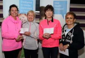 l-r Maureen Walsh, CEO DeCare Dental Claremorris, presenting prizes in the 2014 DeCare Dental Sport a Smile Claremorris 5 to Margaret Glavey, Mayo AC,  1st woman  o50,  Pauline Moran (Mayo AC)  2nd woman finisher, Imelda Hughes (Kilmaine) 3rd woman  Photo: © Michael Donnelly