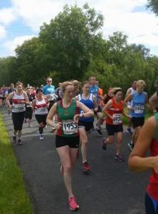 Maria Kneafsey checks her connection at Roscommon 10k start