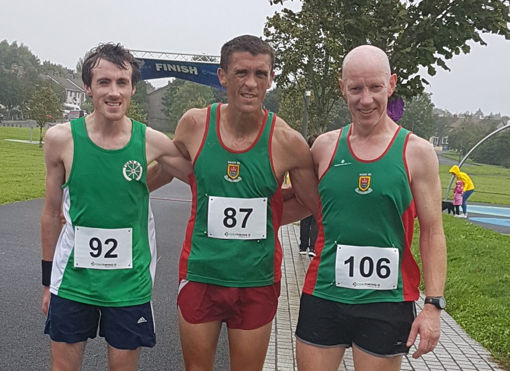 Top three finishers l-r Daire Comer (Tuam AC) 3rd, winner John Byrne and David Tiernan 2nd - both Mayo AC